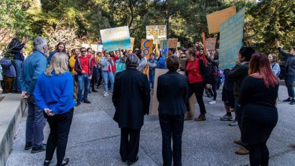 Graduate students marched on Kerr Hall, where the administration offices reside, to deliver their demands to the chancellor on Nov. 7. Watching in the foreground, with their backs to the camera, are Chancellor Cynthia Larive and Executive Vice Chancellor Lori Kletzer.