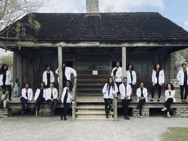 """Russell Ledet, a second-year medical student (top row, third from left) organized an outing for 14 of his fellow African American classmates to a former plantation that had slave quarters. Ledet says he would caption this photo """"Our Moment of Resiliency."""""""