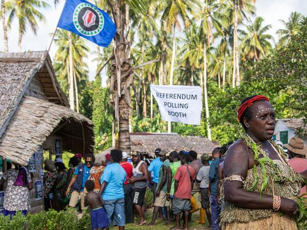People line up to vote in a referendum on Bougainville's independence from Papua New Guinea, in the region's interim capital of Buka Town, on Nov. 25. The pro-secession vote won a landslide victory, although the vote is nonbinding. Now Bougainville's leaders have to negotiate with the PNG government.