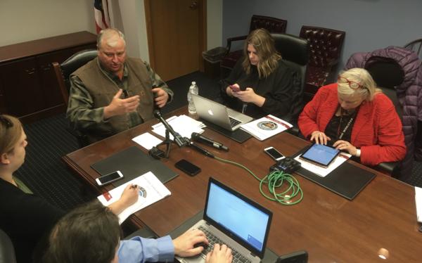 Ohio House Speaker Larry Householder talks to reporters