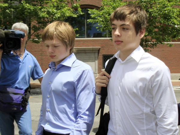 Alexander Vavilov (right), shown in 2010 with older brother Timothy, leave a federal court in Boston after a hearing for their parents, who worked for the Russian foreign intelligence service starting in the 1980s.