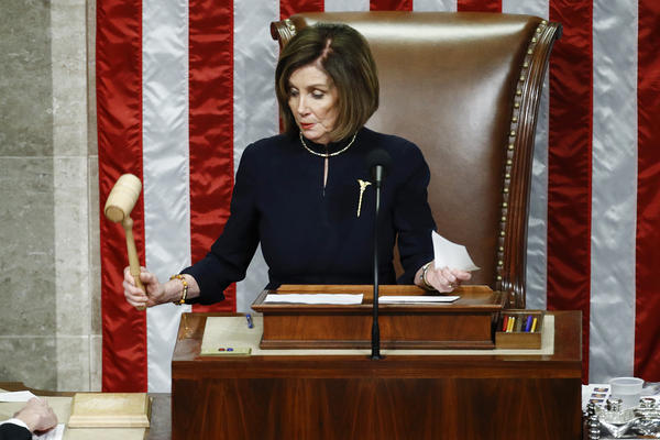 House Speaker Nancy Pelosi of Calif., strikes the gavel after announcing the passage of article II of impeachment against President Donald Trump, Wednesday, Dec. 18, 2019, on Capitol Hill in Washington. (Patrick Semansky/AP)
