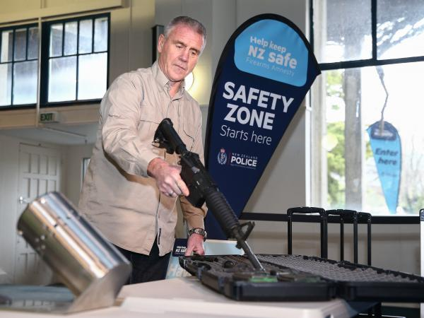 A gun is prepared for use in a bullet trap as part of a demonstration during a firearm buy-back collection event on July 4 in Wellington, New Zealand.