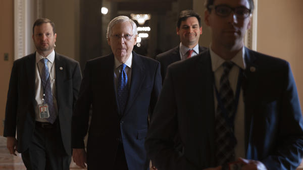 Senate Majority Leader Mitch McConnell laughed Monday when asked about Democrats' decision to delay sending articles of impeachment to his chamber. The tension comes amid debate over whether the trial will include witnesses.