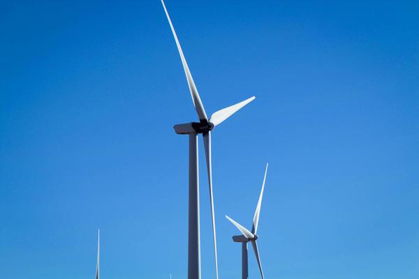 A wind turbine rises over Kansas.