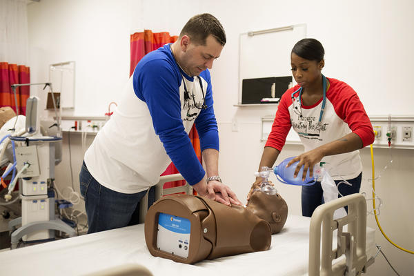 Respiratory care students Harry Painter Jr. and Darielle Griffin work with a mannequin to get hands-on training at St. Louis Community College's new health care facility on the Forest Park campus.