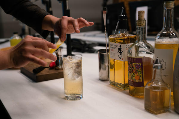 """Barman Eddie Kim created the light and crisp """"Truth and Clarity"""" cocktail — combining Capitoline White Vermouth, Suntory Toki Whisky, club soda and lemon vinegar — to ring in the new year."""