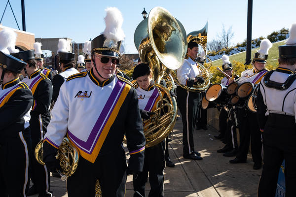 Frank Stanek stands in loose formation with fellow members of the Ashland Marching Band before performing their pre-game show at Jack Miller Stadium, Ashland University, Ashland, Ohio. The day marked Stanek's last performance with the marching band.