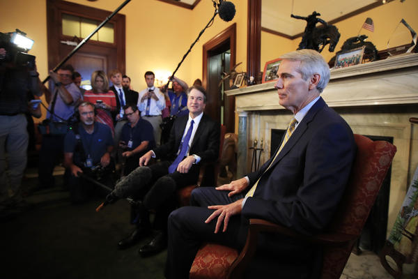Supreme Court nominee Brett Kavanaugh meets Sen. Rob Portman, R-Ohio, on Capitol Hill in Washington, Wednesday, July 11, 2018.