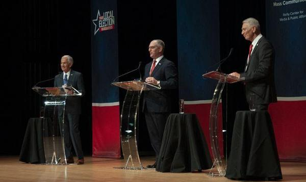 Republican businessman Eddie Rispone (left) Democratic Gov. John Bel Edwards (middle) and Congressman Ralph Abraham (right) on the debate stage Sept. 19. Edwards and Rispone will face off in a Nov. 16 runoff in the Louisiana governor's race.