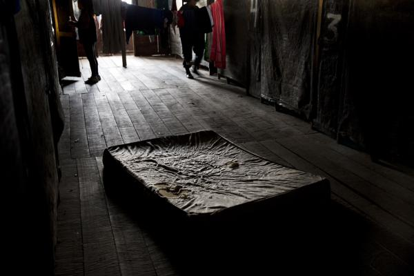 In this Tuesday, Feb. 23, 2016 photo, a worn mattress lays on the floor of a brothel during a police raid on a nearby wildcat gold mine in La Pampa in the Madre de Dios region of Peru.