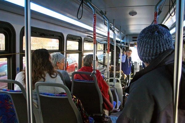 Local officials ride the new Poudre Express bus during a test run last fall. The route welcomed its first riders on Jan. 2.