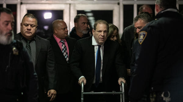 Harvey Weinstein (center) leaves a bail hearing last month in New York City. The former Hollywood megaproducer has been accused of sexual misconduct by dozens of women. He now faces five charges in New York City.