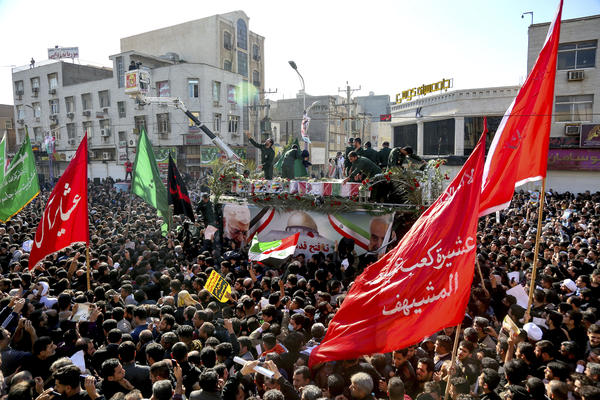 In this photo provided by the Iranian Students' News Agency, flag-draped coffins of Gen. Qassem Soleimani and others who were killed in Iraq in a U.S. drone strike are carried on a truck surrounded by mourners in the Iranian city of Ahvaz on Sunday.