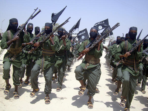 Al-Shabab fighters march with their weapons during military exercises on the outskirts of Mogadishu, Somalia, in 2011.