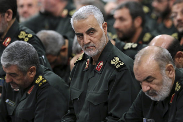 In this Sept. 18, 2016, file photo provided by an official website of the office of the Iranian supreme leader, Revolutionary Guard Gen. Qassem Soleimani, center, attends a meeting in Tehran, Iran. (Office of the Iranian Supreme Leader via AP, File)