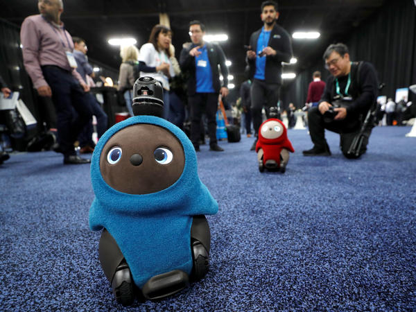 Lovot companion robots by Groove X wander at the Consumer Electronics Show in Las Vegas.