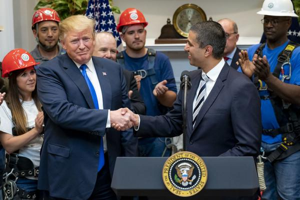 President Donald J. Trump listens as Chairman Ajit Pai of the Federal Communications Commission delivers remarks on U.S. 5G deployment technology