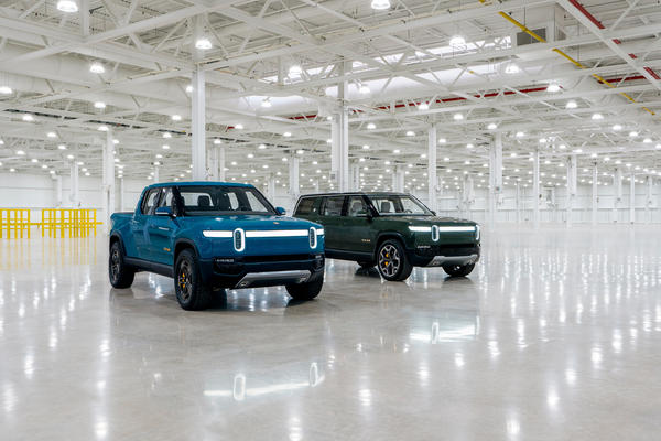 Rivian's R1T pickup and R1S sport utility vehicle inside the Normal manufacturing plant.