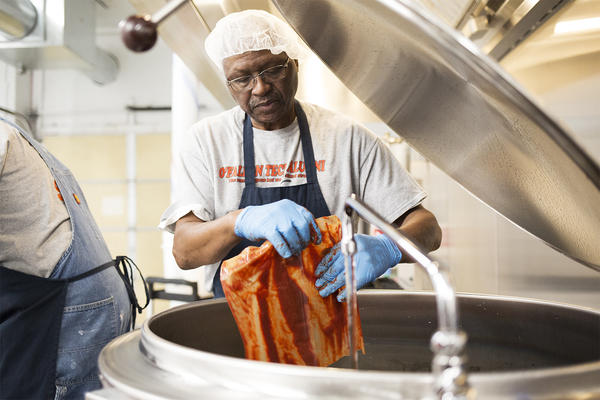 Freddie Lee James Jr., owner of Freddie Lee's Gourmet Sauces, starts a batch of his sauce at his commercial kitchen space near downtown St. Louis.