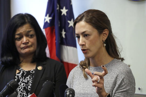 Rep. Pramila Jayapal, D-Wash., looks on as Negah Hekmati talks about her hours-long delay returning to the U.S. from Canada with her family days earlier, at a news conference on Monday.