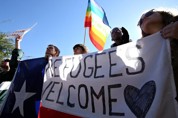 Demonstrators protest Gov. Greg Abbott's opposition to resettle Syrian refugees in Texas, at the governor's mansion in 2015.