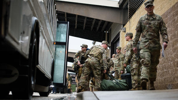 Troops from the Army's 82nd Airborne Division prepare to deploy to the Middle East on Saturday at Fort Bragg, N.C.