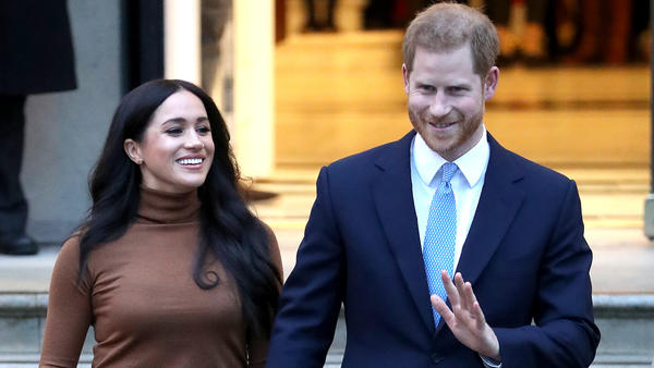 The Duke and Duchess of Sussex, also known as Prince Harry and Meghan Markle, have announced that they will step back from certain royal duties. The couple is seen here on Tuesday in London.