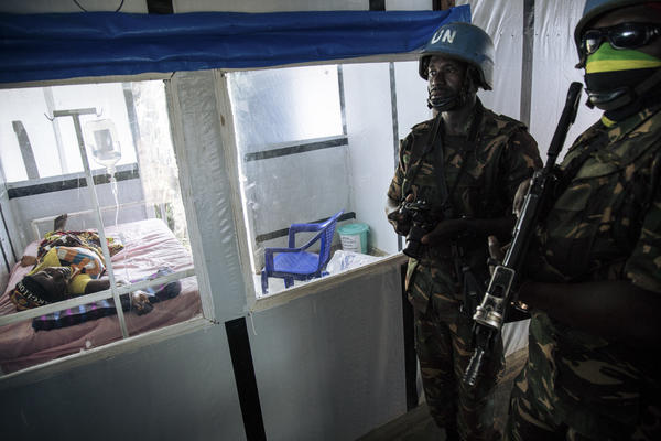 United Nations peacekeepers stand next to a patient during a visit of the UN secretary-general at an Ebola treatment centre in Mangina, North Kivu province, on September 1, 2019.