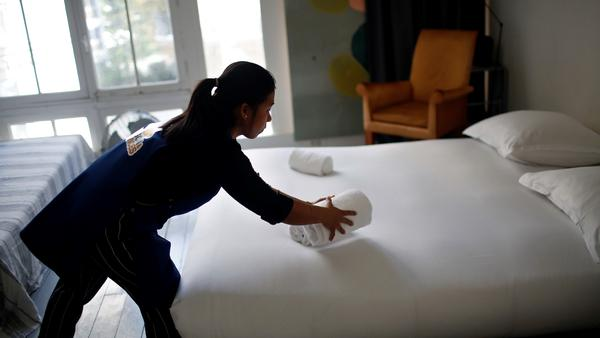 A cleaning lady works at an Airbnb in this 2018 file photo.