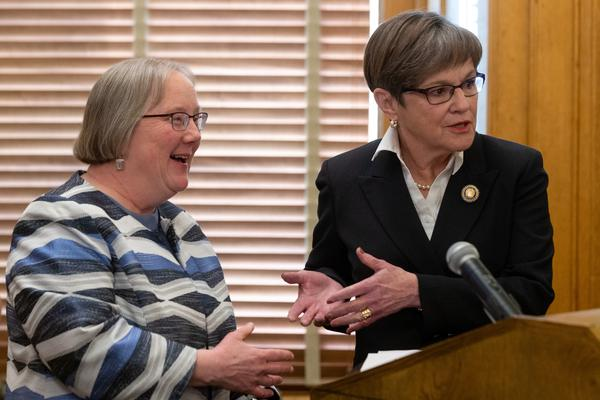 Gov. Laura Kelly (right) is proposing the creation of a new state agency that would incorporate several welfare programs, including the entire Department for Children and Families. Laura Howard (left) would oversee the new agency.