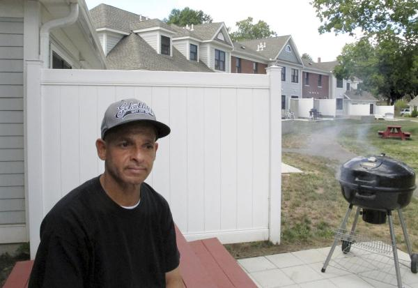 Luis Vazquez, a Navy veteran who was homeless off and on for 10 years, sits outside his home in a veterans' housing complex in Newington, Conn., in 2015.
