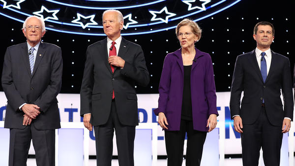 Bernie Sanders, Joe Biden, Elizabeth Warren and Pete Buttigieg appear at the start of the Democratic debate at Otterbein University on Oct. 15 in Ohio. The four enter Tuesday's debate as the top contenders in Iowa.