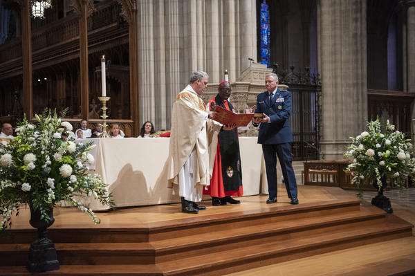 The Rev. Randolph Hollerith, dean of the Washington National Cathedral (from left); the Rt. Rev. Carl Wright, the Episcopal Church's bishop suffragan for the armed forces; and Maj. Gen. Steven Schaick, the Air Force chief of chaplains, participate in the blessing of a Bible for swearing in U.S. Space Force officials.