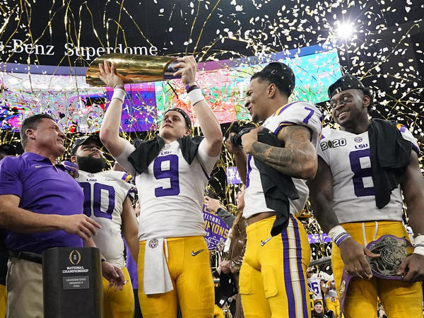 LSU quarterback Joe Burrow holds the trophy after the team's win against Clemson in the NCAA College Football Playoff National Championship game on Monday in New Orleans.