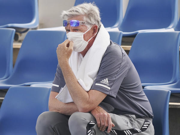 A spectator wears a mask to cope with the smog during an Australian Open practice session at Melbourne Park. Poor air quality caused practice sessions to be suspended on Tuesday.