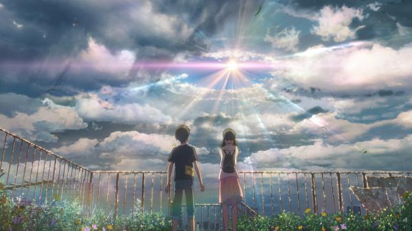 In writer/director Makoto Shinkai's latest animated feature, Hodaka (voiced by Kotaro Daigo, L) meets Hina (voiced by Nana Mori, R), a girl who can stop the rain.