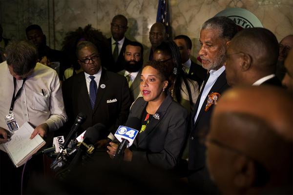 St. Louis Circuit Attorney Kim Gardner, shown with supporters in 2019, has filed suit against the city and six other defendants alleging a racist conspiracy against her reform agenda.