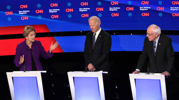 Democratic presidential candidates (from left) Sen. Elizabeth Warren of Massachusetts, former Vice President Joe Biden and Sen. Bernie Sanders of Vermont participate in Tuesday night's primary debate in Des Moines, Iowa.