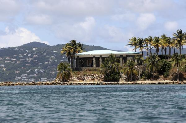 A view of Jeffrey Epstein's mansion on Little St. James Island. Prosecutors filed a civil lawsuit that accuses Epstein of human trafficking that victimized young women and children as young as 11.
