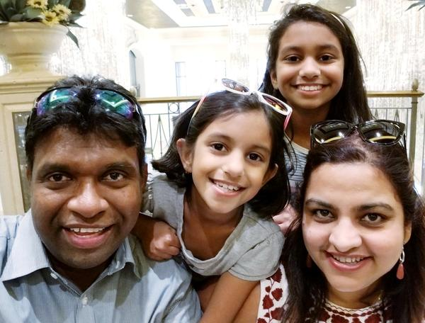 Puneet Chowdhary is one of hundreds of thousands of people living and working in the United States who is waiting for a green card. She met her husband in the United States, and they have two kids together.