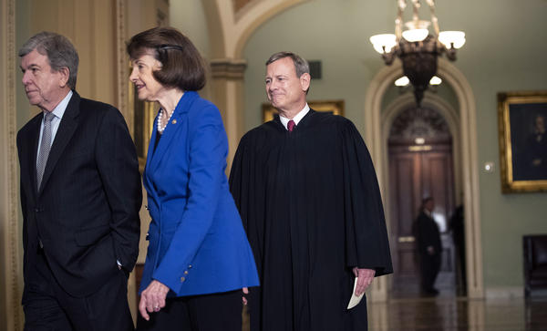 Sen. Roy Blunt, R-Mo. (left); Sen. Dianne Feinstein, D-Calif.; and Supreme Court Chief Justice John Roberts arrive to the Senate chamber for impeachment proceedings on Thursday.