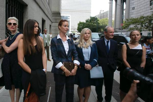 Attorney David Boies (second from right) walks with alleged sexual abuse victims of Jeffrey Epstein, including Virginia Roberts Giuffre (left of Boies), as they enter the Thurgood Marshall United States Courthouse in New York City.