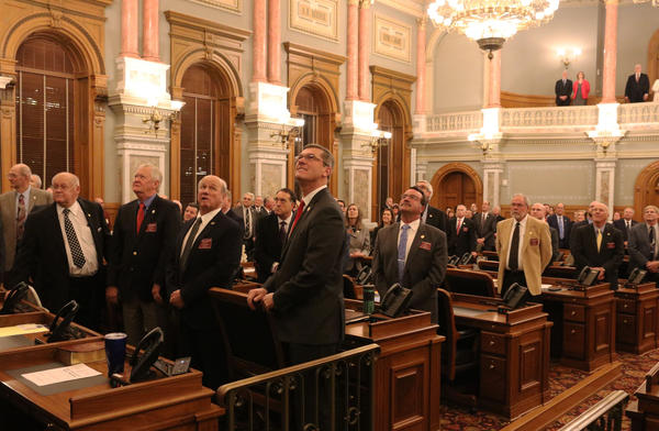 Lawmakers look up into the House's press gallery ahead of the Kansas State of the State address.