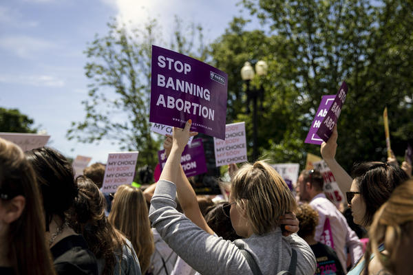 Abortion-rights supporters demonstrate last May in front of the U.S. Supreme Court in Washington. A high court decision in a case that could curtail or even overturn <em>Roe v. Wade</em> is set for opening arguments in March.
