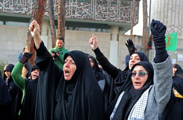 Supporters of the Basij, a militia loyal to the Islamic republic's establishment, chant anti-US slogans during a memorial for the victims of the Ukraine plane crash. Iran announced its first arrests over the shooting down of a Ukrainian airliner last week, as it struggles to contain the fallout from the disaster that sparked three days of protests.
