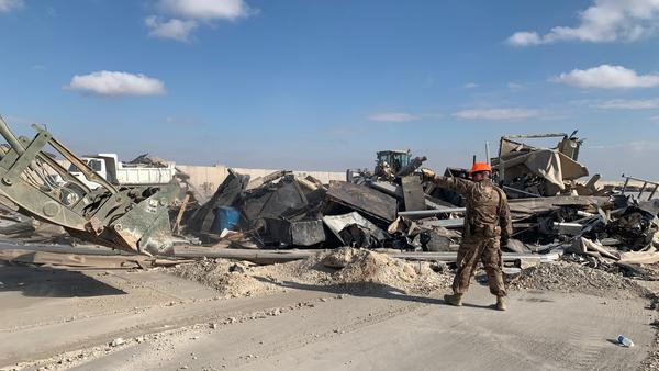 U.S. troops clear debris following an Iranian missile strike at the Ain al-Assad air base in Iraq on Jan. 8. No one was killed, and U.S. officials initially said no American service members had been injured.