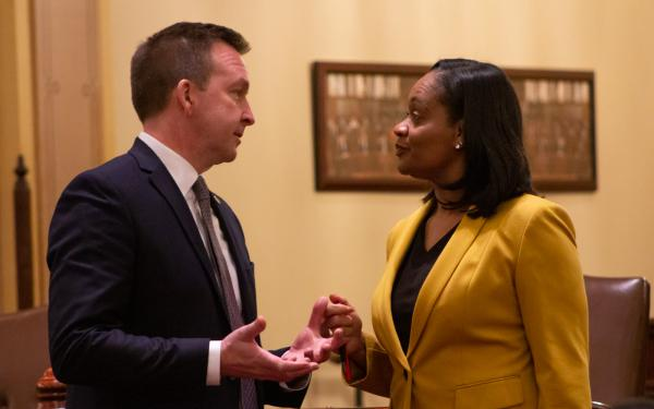 Sen. Kim Lightford, right, confers with Sen. Andy Manar, before the vote for Senate president. Manar was an early backer of Lightford's campaign for the Senate presidency.