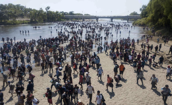Central American migrants cross the Suchiate River by foot from Guatemala (left) to Ciudad Hidalgo, Mexico, on Monday.
