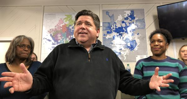 Before taking office, Gov. J.B. Pritzker thanked campaign supporters in Springfield in this file photo from December 2018. His personal attorneys are trying to keep Pritzker and Lt. Gov. Juliana Stratton, right, from sitting for depositions in a lawsuit.